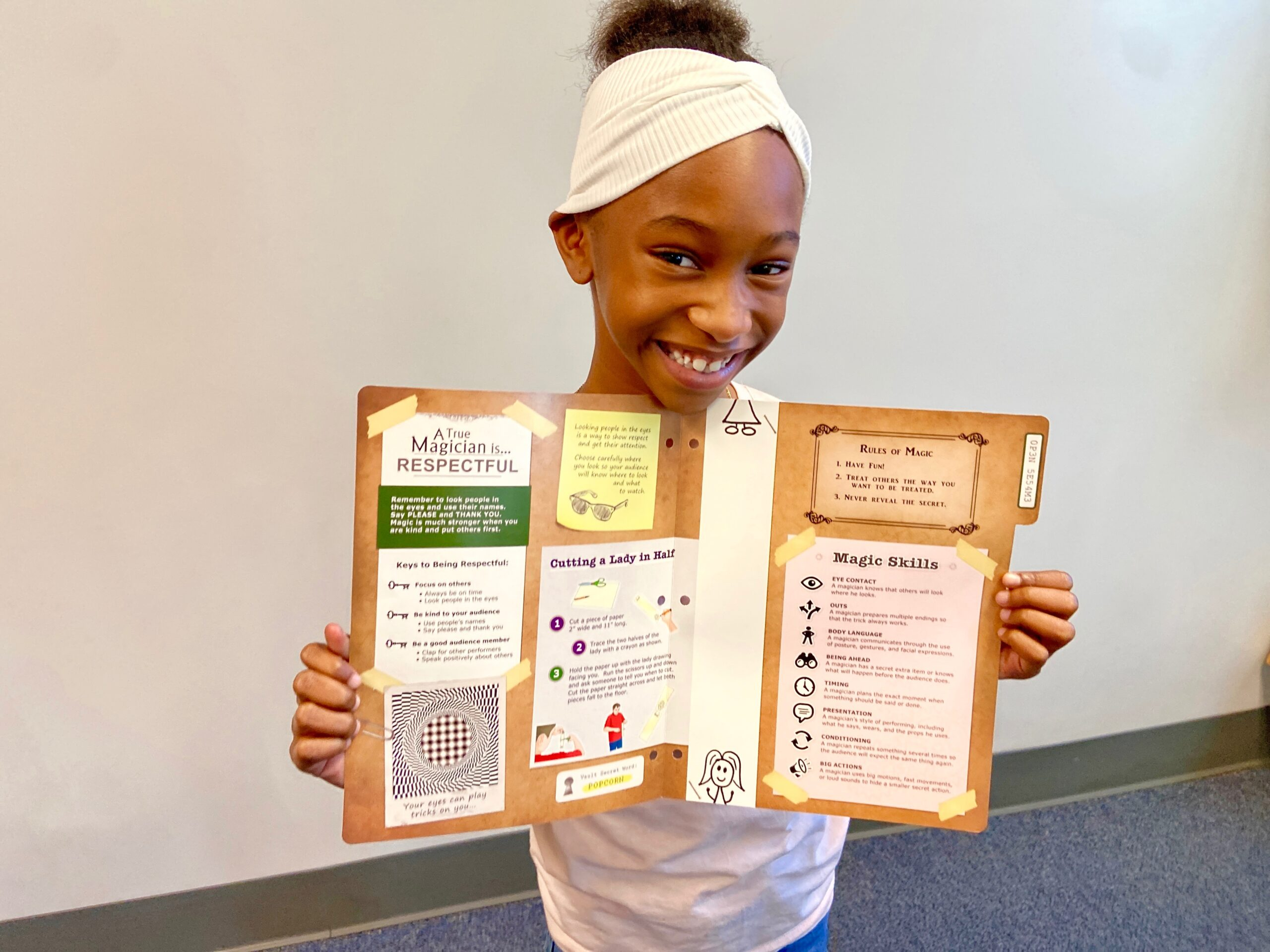 Student shows folder